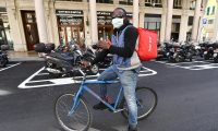 A delivery rider in Genoa, Italy, 19 March 2020: 'Uniting against the pandemic in a show of spontaneous patriotism ultimately makes the nation more cohesive.' Photograph: Luca Zennaro/EPA