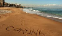 The word Corona written in the sand on the beach in Lebanon's southern city of Saida. amid the spread of coronavirus in the country. Photo by MAHMOUD ZAYYAT/AFP via Getty Images.