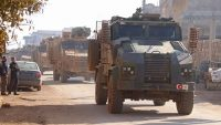 A Turkish army convoy drives through the Syrian village of Ram Hamdan, north of the city of Idlib, on 25 February, 2020. Ahmad Al-Atrash/AFP