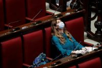 Maria Teresa Baldini of the far-right Fratelli d'Italia (Brothers of Italy) party wears a protective mask and gloves inside parliament after Italy's lockdown. Photograph: Remo Casilli/Reuters