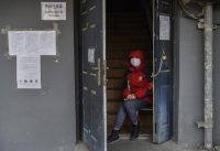 Kevin Frayer/Getty Images A neighborhood committee member guarding the entrance of a residential building as efforts continued to control the spread of coronavirus infection, Beijing, China, February 28, 2020