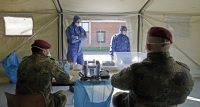 Soldiers of the German army at a coronavirus testing site in Sankt Wendel, Germany, on Thursday. Credit Ronald Wittek/EPA, via Shutterstock