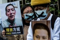 Isaac Lawrence/AFP via Getty Images Pro-democracy activists holding pictures of missing citizen journalist Fang Bin and anti-corruption activist Xu Zhiyong, who had been interrogating President Xi Jinping's handling of the Covid-19 crisis, at a protest outside the Chinese liaison office in Hong Kong, February 19, 2020