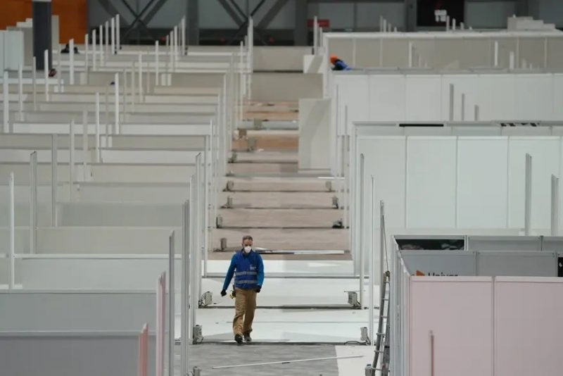 Workers install a field hospital for coronavirus patients in Madrid on 21 March. Photograph: Getty Images