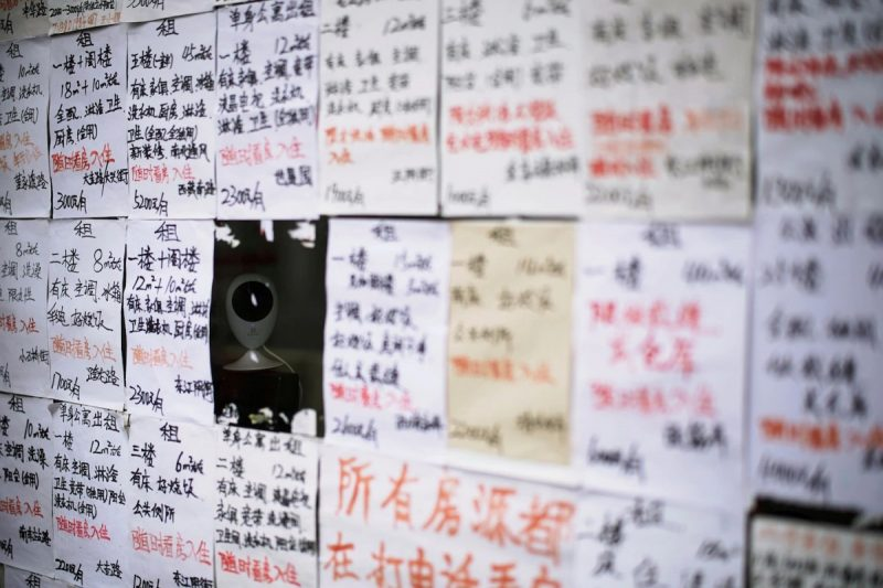 A surveillance camera is seen in a display window of a real estate agent in Shanghai last week. (Aly Song/Reuters)