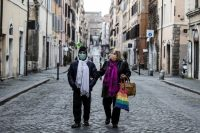People wearing protective face masks walk in the Borgo Pio district in Rome on Tuesday. (Angelo Carconi/EPA-EFE/REX/Shutterstock)