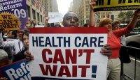"""A """"Big Insurance: Sick of It"""" rally in New York City. Photo by Mario Tama/Getty Images."""