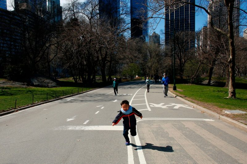 Kena Betancur/AFP via Getty Images A child running in Central Park, New York City, March 22, 2020