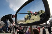 People attend a demonstration of military equipment and hardware on the Defender of the Fatherland Day in Sevastopol, Crimea, on Feb. 23. (Alexey Pavlishak/Reuters)