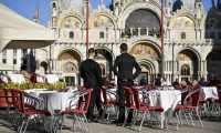 Empty tables at a restaurant in St Mark's square in Venice: coronavirus has highlighted the role public spaces normally play in European life.