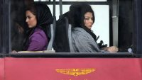 Iranian women sit on a bus in Tehran on February 25, 2012. ATTA KENARE/AFP