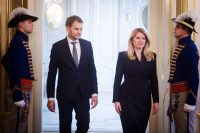 Igor Matovic, leader of anti-graft political movement Ordinary People and Independent Personalities, and Slovak President Zuzana Caputova arrive Monday for informal talks after the country's parliamentary election at the presidential palace in Bratislava. (Vladimir Simicek/Afp Via Getty Images)