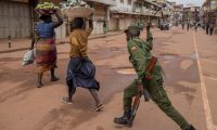 Fruit vendors are chased off the streets of Kampala. Photograph: Badru Katumba/AFP via Getty Images