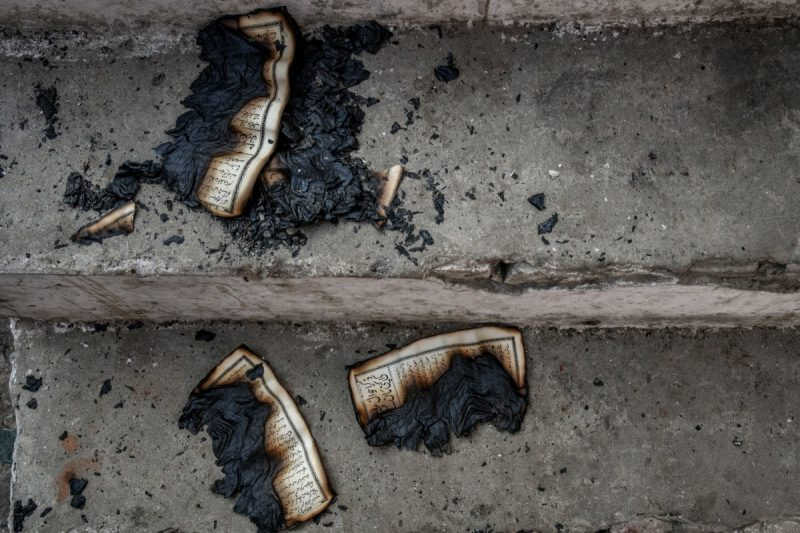 Pages of a Quran burned by rioters in a mosque in northeast Delhi on Feb. 26. Credit Atul Loke for The New York Times