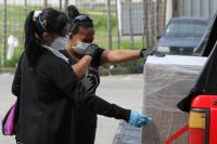 A woman cries after a relative died of covid-19 in Guayaquil, Ecuador. (Getty Images)
