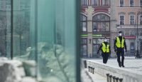 Police officers wearing protective face masks patrol during coronavirus lockdown enforcement in Wroclaw, Poland. Photo by Bartek Sadowski/Bloomberg via Getty Images.