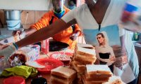 Volunteers in South Africa prepare food parcels during lockdown: 'South African's approach stands in stark contrast with Jair Bolsonaro's denialism or Donald Trump's divisive actions.' Photograph: Luca Sola/AFP via Getty