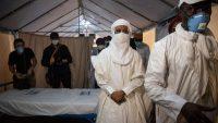 Prime Minister of Niger, Brigi Rafini (C), wearing a protective mask, visits a unit at the Seyni Kountche stadium in Niamey, Niger, on April 17, 2020, during the novel coronavirus COVID-19 outbreak's lockdown. Nicolas Réméné / AFP