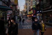A street in Seoul, South Korea, last week. Initially in short supply, face masks became more widely available after the government purchased a substantial proportion of national production.Credit...Ed Jones/Agence France-Presse — Getty Images