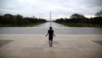 Exercising in front of a deserted Lincoln Memorial in Washington, DC. Photo by Win McNamee/Getty Images.
