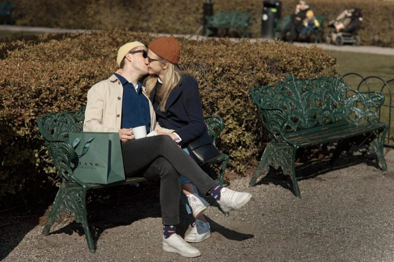 A couple kiss at a park in Stockholm on April 4. (Andres Kudacki/AP)