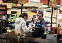 Erin Clark for The Boston Globe via Getty Images A cashier scanning the groceries of a customer at a Whole Foods, Cambridge, Massachusetts, March 24, 2020