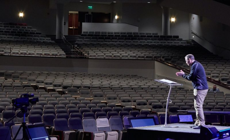 Adam Bettcher/Getty Images Pastor Troy Dobbs speaking to empty pews after Grace Church Eden Prairie moved to online services, Eden Prairie, Minnesota, March 15, 2020