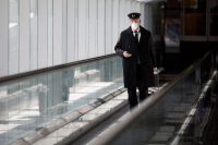 Cole Burston/Getty Images A pilot leaving Toronto Pearson International Airport, Toronto, Canada, April 1, 2020; Air Canada announced it would temporarily lay off over 15,000 employees and reduce activity by up to 90 percent due to Covid-19
