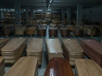 Coffins of coronavirus victims, to be buried or incinerated, were stored in the underground parking lot of a funeral home in Barcelona on Thursday.Credit Samuel Aranda for The New York Times