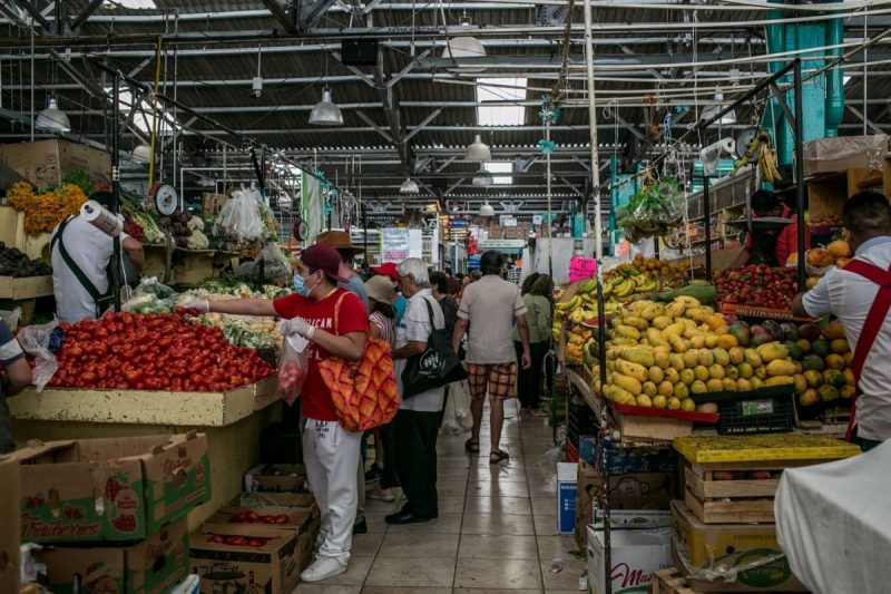 Mercado la Dalia, in Mexico City's neighborhood of Santa Maria la Ribera, is still seeing some activity, though now there are restrictions on the number of people who can enter. (Meghan Dhaliwal/FTWP)