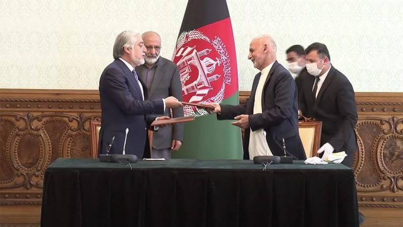 Abdullah Abdullah, left, and President Ashraf Ghani signing a power-sharing deal in Kabul, Afghanistan, on 17 May 2020. Screenshot of video recording by the Presidential Palace of Islamic Republic of Afghanistan - ARG