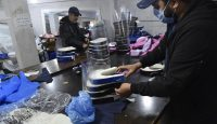Algerian volunteers prepare personal protection equipment (PPE) to help combat the coronavirus epidemic in the capital Algiers. Photo by RYAD KRAMDI/AFP via Getty Images.