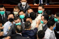 A scuffle broke out between pro-democracy and pro-Beijing members of Hong Kong's Legislature on May 18. Credit Anthony Wallace/Agence France-Presse — Getty Images