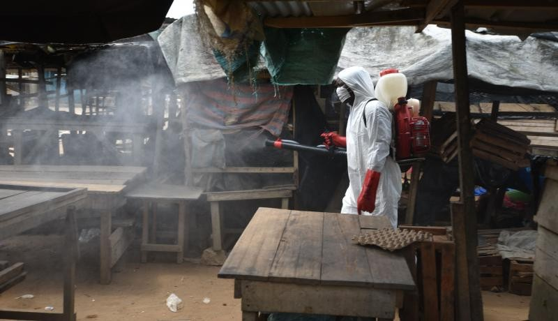 An informal market in the Anyama district of Abidjan, Côte d'Ivoire, is sanitized against the coronavirus. Photo by SIA KAMBOU/AFP via Getty Images.