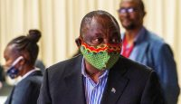 Cyril Ramaphosa at NASREC Expo Centre in Johannesburg where facilities are in place to treat coronavirus patients. Photo by JEROME DELAY/POOL/AFP via Getty Images.
