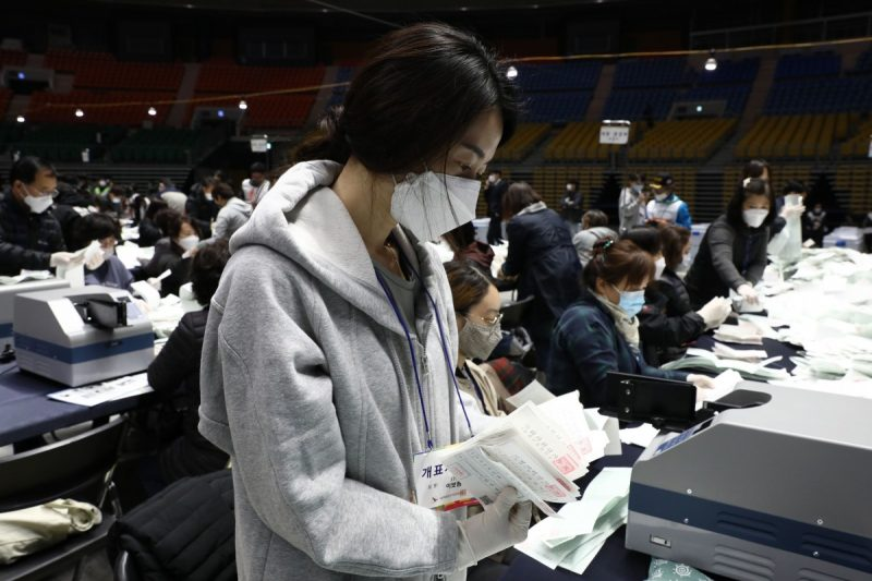 Officials from the South Korean Central Election Management Committee and election observers in Seoul count votes cast for the April 15 parliamentary election. (Chung Sung-Jun/Getty Images)