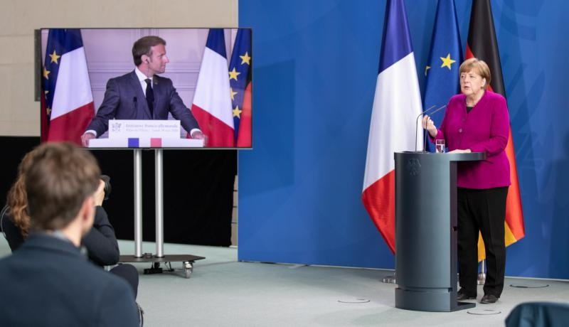 German chancellor Angela Merkel and French president Emmanuel Macron (via video) announce a joint EU recovery initiative to tackle the coronavirus crisis. Photo by Andreas Gora - Pool/Getty Image.