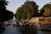 People on the Landwehr Canal in Berlin, May 9. Credit Christian Mang/Reuters
