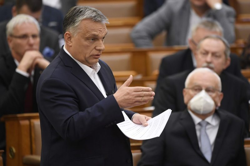 In this March 23, 2020, file photo, Hungarian Prime Minister Viktor Orban delivers his speech about the current state of the coronavirus outbreak during a plenary session in the House of Parliament in Budapest, Hungary. The Hungarian Parliament granted Orban the power to rule indefinitely by decree, unencumbered by existing laws or judicial or parliamentary restraints. One aspect of the law ostensibly passed to cope with the coronavirus calls for prison terms of up to five years for those convicted of spreading falsehoods or distorted facts during the emergency. (Tamas Kovacs/MTI via AP, File)