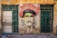 A faded mural of the Cuban revolutionary Che Guevara in Old Havana. Credit Nicolas Economou/NurPhoto, via Getty Images