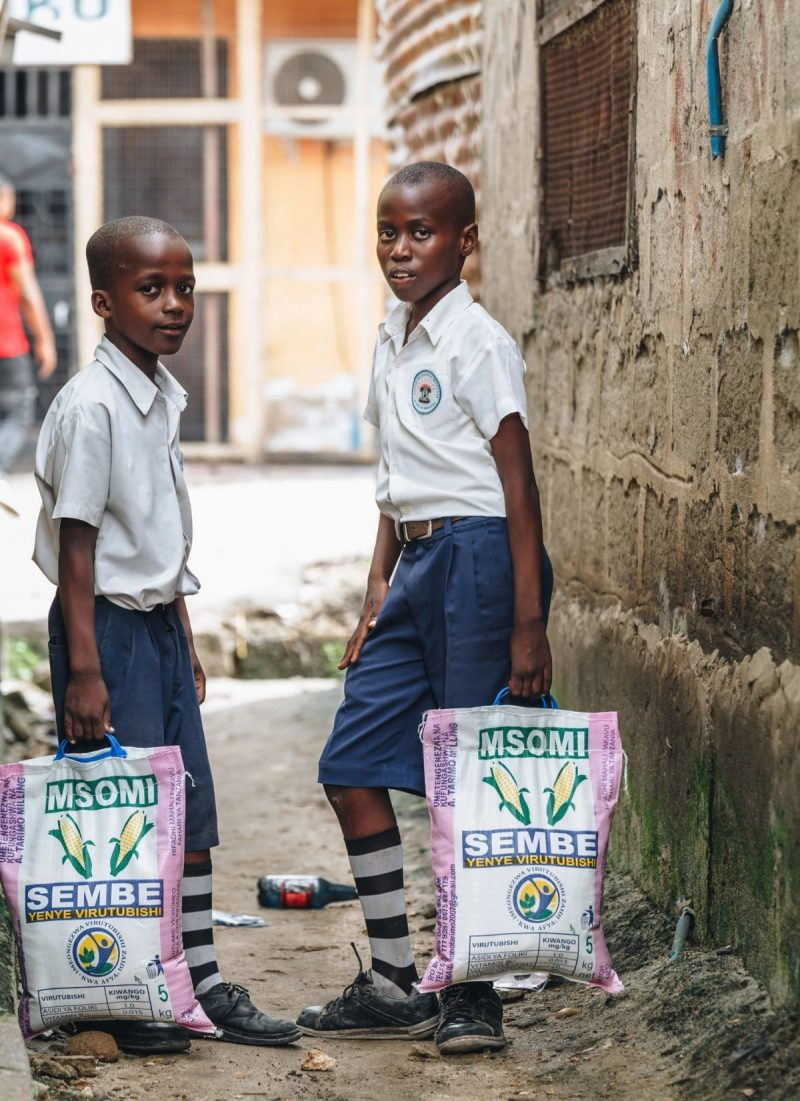 Before schools were closed in Tanzania because of the coronavirus, children walked home with sacks of fortified flour received there. Credit Malicky Boaz/Sanku