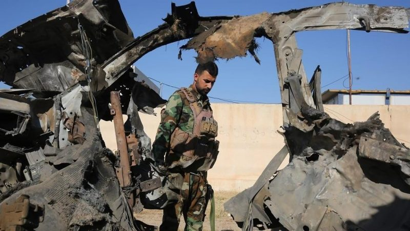 An Iraqi fighter with the Popular Mobilisation Forces inspects the site of the Islamic State (IS) group attack, May 3, 2020. AFP/AHMAD AL-RUBAYE