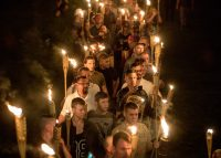 "Chanting ""White lives matter!,"" several hundred white nationalists and white supremacists carrying torches marched in Charlottesville on Aug. 11, 2017. (Evelyn Hockstein for The Washington Post)"