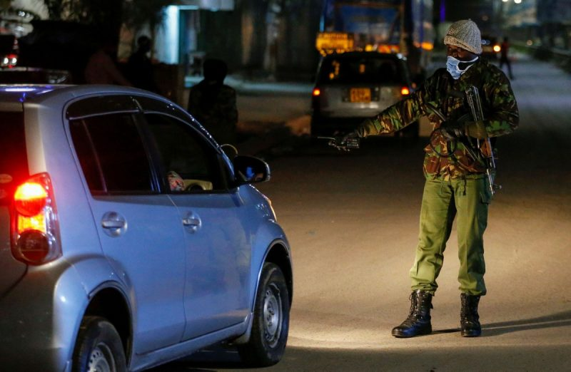 A police officer stops a car during lockdown restrictions set by the government to prevent spread of the coronavirus, in Eastleigh district of Nairobi on Wednesday. (Thomas Mukoya/Reuters)