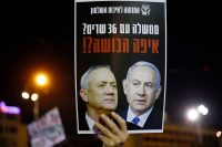 A placard with a picture of Prime Minister Benjamin Netanyahu and his rival-turned-partner Benny Gantz at a demonstration in Tel Aviv on May 2. (Jack Guez/AFP/Getty Images)