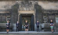 Jane Barlow/AFP via Getty Images Scottish First Minister Nicola Sturgeon, center, observing a minute's silence to honor health service workers who have died during the Covid-19 outbreak, outside St. Andrew's House, Edinburgh, April 28, 2020