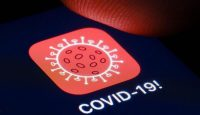 Tracking app for COVID-19 on a smartphone. Photo by Thomas Trutschel/Photothek via Getty Images.