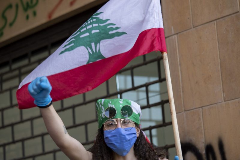 An antigovernment protester in Beirut on Monday. (Hassan Ammar/AP)