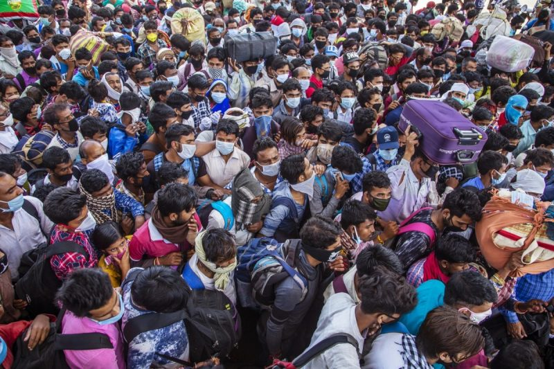 Indian migrant workers and their families crowding to board buses in Ghaziabad, on the outskirts New Delhi to return to their native villages, during the nationwide coronavirus lockdown in March. Credit Getty Images/Getty Images