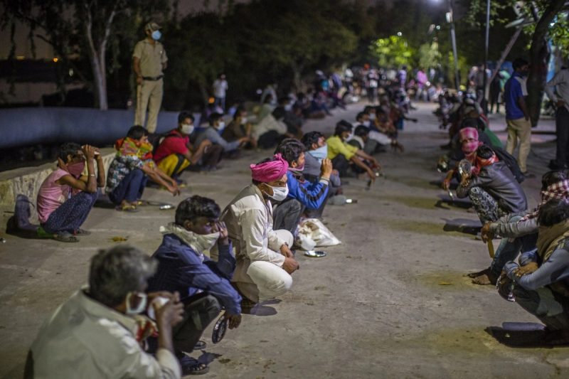 Indian migrant workers, daily wagers, laborers and homeless people in New Delhi, waiting for food outside a government-run shelter, in April. Credit Yawar Nazir/Getty Images